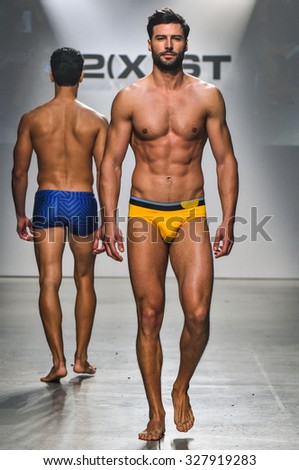NEW YORK, NY - OCTOBER 14: Model walks the runway during 2(X)IST Men's Spring/Summer 2016 Runway Show at Skyline Modern on October 14, 2015 in NYC - stock photo