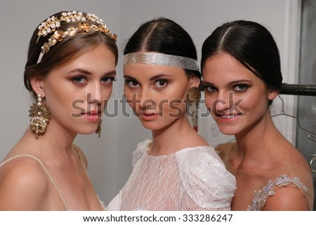 NEW YORK, NY - OCTOBER 10: Models pose backstage during the Julie Vino Bridal Fall/Winter 2016 Presentation at EZ Studio on October 10, 2015 in NYC. - stock photo