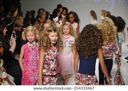 NEW YORK, NY - OCTOBER 18: Models walk the runway during the Imoga preview at petitePARADE / Kids Fashion Week at Bathhouse Studios on October 18, 2014 in New York City. - stock photo