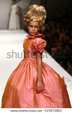 NEW YORK, NY - SEPTEMBER 10: A model walks the runway at the Nancy Vuu fashion show during Spring 2016 New York Fashion Week at Gotham Hall on September 10, 2015 in New York City. - stock photo
