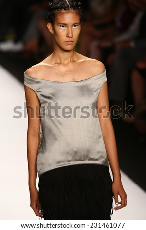 NEW YORK, NY - SEPTEMBER 05: A model walks the runway at the Project Runway (Alexander Knox) show during MBFW Spring 2015 at Lincoln Center on September 5, 2014 in NYC - stock photo
