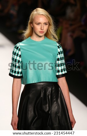 NEW YORK, NY - SEPTEMBER 05: A model walks the runway at the Project Runway (Korina Emmerich) show during Mercedes-Benz Fashion Week Spring 2015 at Lincoln Center on September 5, 2014 in NYC - stock photo