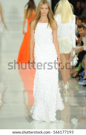 NEW YORK, NY - SEPTEMBER 12: A model walks the runway at the Ralph Lauren fashion show during Mercedes-Benz Fashion Week Spring 2014 on September 12, 2013 in New York City. - stock photo