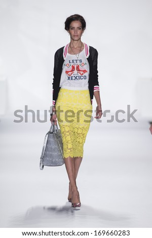 NEW YORK, NY - SEPTEMBER 06: A model walks the runway at the Rebecca Minkoff show during Spring 2014 Mercedes-Benz Fashion Week at The Theatre at Lincoln Center on September 6, 2013 in New York City. - stock photo