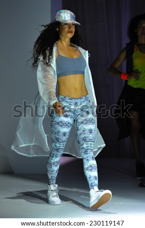 NEW YORK, NY - SEPTEMBER 03: A model walks the runway during the Athleta  Runway show during Mercedes-Benz Fashion Week Spring 2015 at SIR Stage on September 3, 2014 in NYC. - stock photo