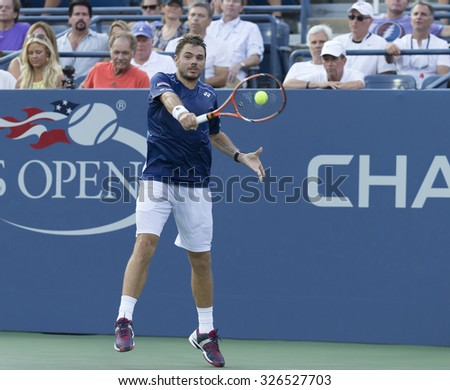 New York, NY - September 1, 2015: Albert Ramos-Vinolas of Spain returns ball during 1st round match against  Stan Wawrinka of Switzerland at US Open Championship - stock photo