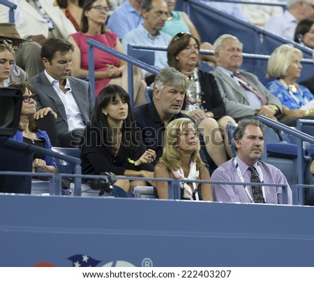 NEW YORK, NY - SEPTEMBER 2, 2014: Alec Baldwin, Hilaria Thomas attend 4th round match between Roger Federer & Bautista Agut at US Open in Flushing Meadows - stock photo