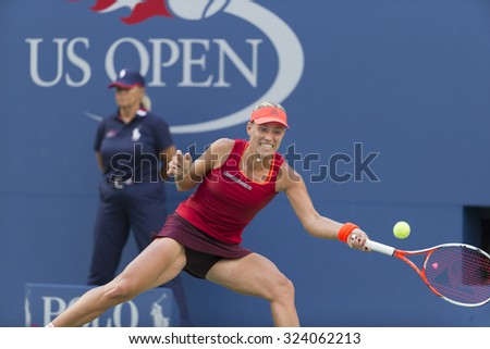 New York, NY - September 5, 2015: Angelique Kerber of Germany returns ball during 3rd round match against Victoria Azarenka of Belarus at US Open Championship - stock photo