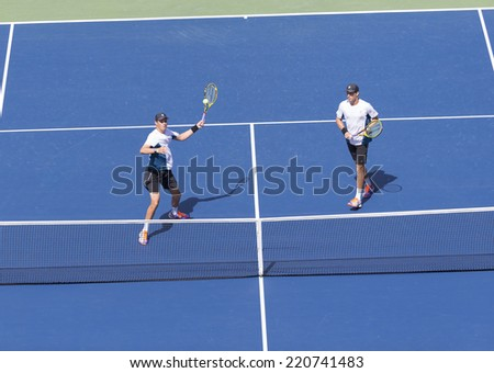 NEW YORK, NY - SEPTEMBER 7, 2014: Bryan brothers of USA return ball during men doubles final match against Marcel Granollers & Marc Lopez of Spain at US Open championship in Flushing Meadows - stock photo