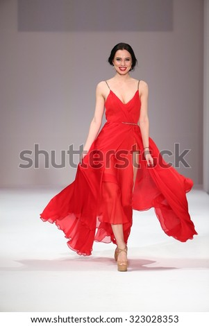 NEW YORK, NY - SEPTEMBER 11: Designer Christina Berezchneva walks the runway at the Crisbery's fashion show during Spring 2016 New York Fashion Week at Gotham Hall on September 11, 2015 in NYC. - stock photo