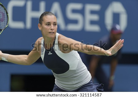 New York, NY - September 11, 2015: Flavia Pennetta of Italy returns ball during semifinal against Simona Halep of Romania at US Open Championship on Ash stadium - stock photo