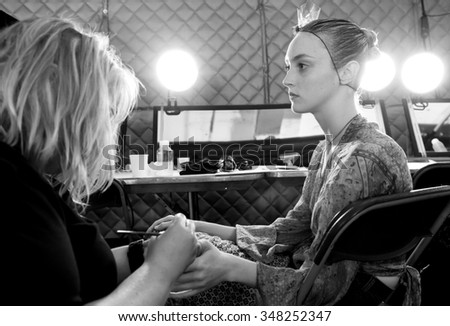 New York, NY - September 12, 2015: Frances Coombe prepares backstage for the Monique Lhuillier Spring 2016 fashion show during New York Fashion Week at The Arc - Skylight Moynihan Station - stock photo