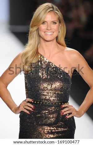 NEW YORK, NY - SEPTEMBER 06: Heidi Klum walks the runway at the Project Runway show during Spring 2014 Mercedes-Benz Fashion Week at Lincoln Center on September 6, 2013 in New York City. - stock photo