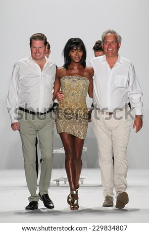 NEW YORK, NY - SEPTEMBER 09: James Mischka (L) and Mark Badgley walk the runway with Naomi Campbell at the Badgley Mischka show during MBFW Spring 2015 at Lincoln Center on September 9, 2014 in NYC - stock photo
