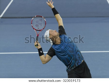 New York, NY - September 3, 2015: Lleyton Hewitt of Australia serves during 2nd round match against Bernard Tomic of Australia at US Open championship - stock photo