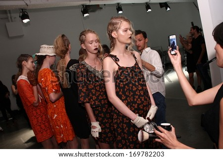 NEW YORK, NY - SEPTEMBER 04: Model are prepped backstage at the Ivana Helsinki fashion show during Mercedes-Benz Fashion Week Spring 2014 at Pier 59 on September 4, 2013 in New York City.  - stock photo