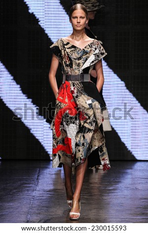 NEW YORK, NY - SEPTEMBER 08: Model Elisabeth Erm walk the runway at Donna Karan New York during MBFW Spring 2015 at 547 West 26th Street on September 8, 2014 in NYC - stock photo