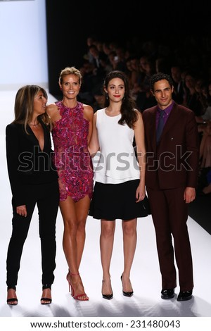 NEW YORK, NY - SEPTEMBER 05: Nina Garcia, Heidi Klum, Emmy Rossum and Zac Posen greet the audience at Project Runway during MBFW Spring 2015 at Lincoln Center on September 5, 2014 in NYC - stock photo