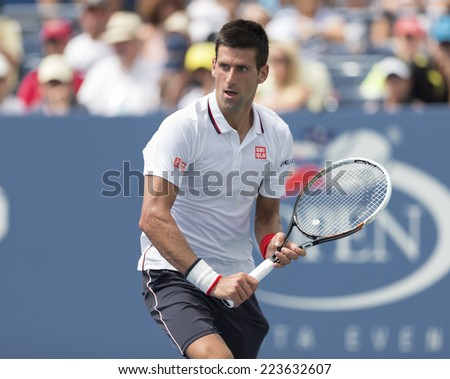 NEW YORK, NY - SEPTEMBER 1, 2014: Novak Djokovic of Serbia returns ball during 4th round match against Phillipp Kphlschreiber of Germany at US Open in Flushing Meadows USTA Tennis Center - stock photo