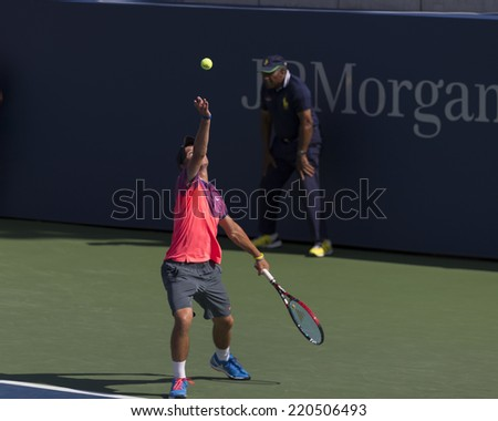 NEW YORK, NY - SEPTEMBER 7, 2014: Omar Jasika ofAustralia serves ball during final boys juniors match against Quentin Halys of France at US Open championship in Flushing Meadows USTA Tennis Center - stock photo