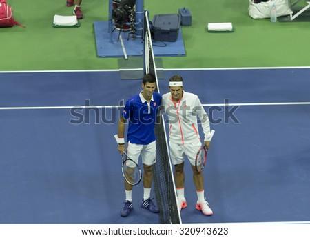 New York, NY - September 13, 2015: Roger Federer of Switzerland & Novak Djokovic of Serbia pose before final of US Open Championship at Ash stadium - stock photo