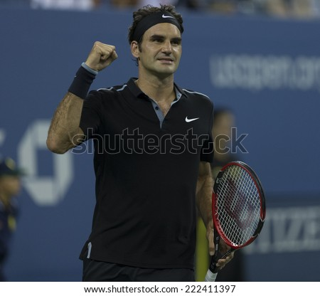 NEW YORK, NY - SEPTEMBER 2, 2014: Roger Federer of Switzerland reacts during 4th round match against Bautista Agut of Spain at US Open in Flushing Meadows USTA Tennis Center - stock photo