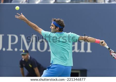 NEW YORK, NY - SEPTEMBER 6, 2014: Roger Federer of Switzerland serves ball during semifinal match against Marin Cilic of Croatia at US Open championship in Flushing Meadows USTA Tennis Center - stock photo