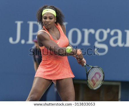 New York, NY - September 6, 2015: Serena Williams of USA returns ball during 4th round against Madison Keys of USA at US Open Championship - stock photo