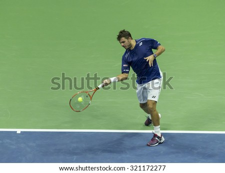 New York, NY - September 11, 2015: Stan Wawrinka of Switzerland returns ball during semifinal against Roger Federer of Switzerland at US Open Championship on Ash stadium - stock photo