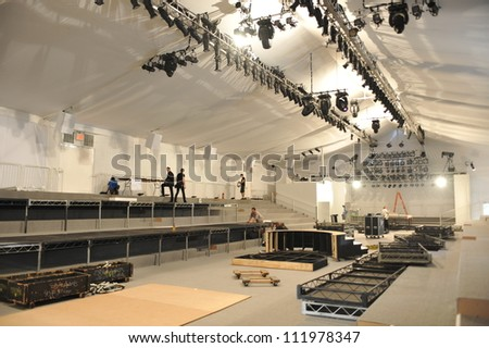 NEW YORK, NY - SEPTEMBER 04 : Workers build tents during Mercedes-Benz Fashion Week at Lincoln Center on September 04, 2012 in New York City. - stock photo