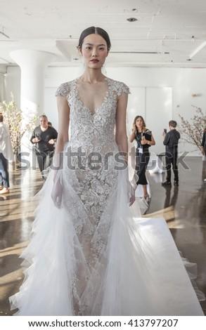 New York, NY, USA - April 13, 2016: A model shows up a wedding dress for Marchesa Spring/Summer 2017 Bridal Presentation at Canoe Studio, Manhattan - stock photo
