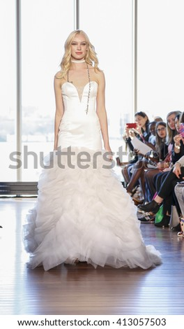New York, NY, USA - April 15, 2016: A model walks runway for RIVINI & Alyne Spring 2017 Bridal Collection by Rita Vinieris at The Standard, High Line during New York International Bridal week, NYC - stock photo