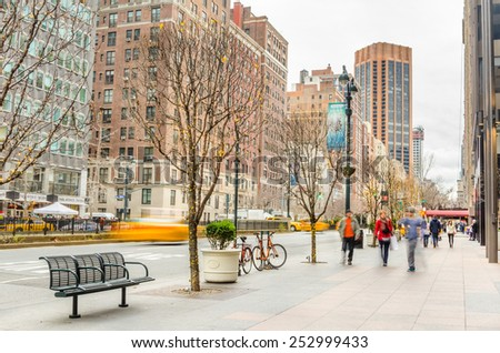 New York, NY, USA - December 28, 2014: People on the pavement along Park Avenue in Midtown Manhattan during the Christmas Holidays. More than 50 million people visit New York every year. - stock photo