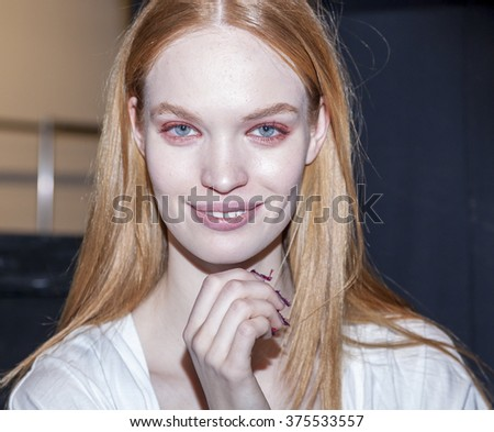 New York, NY, USA - February 11, 2016: A model prepares backstage at the Desigual runway show during of Fall 2016 New York Fashion Week at The Arc, Skylight at Moynihan Station, Manhattan.  - stock photo