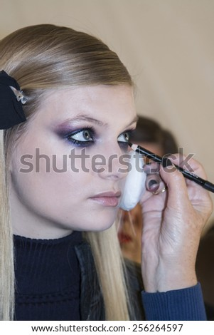 New York, NY, USA - February 13, 2015: A model prepares backstage for Monique Lhuillier Fall 2015 Runway show during Mercedes-Benz Fashion Week New York at the Theatre at Lincoln Center, Manhattan - stock photo