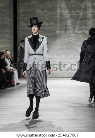 New York, NY, USA - February 18, 2015: A model walks runway for Malan Breton Fall 2015 Runway show during Mercedes-Benz Fashion Week New York at the Pavilion at Lincoln Center, Manhattan - stock photo