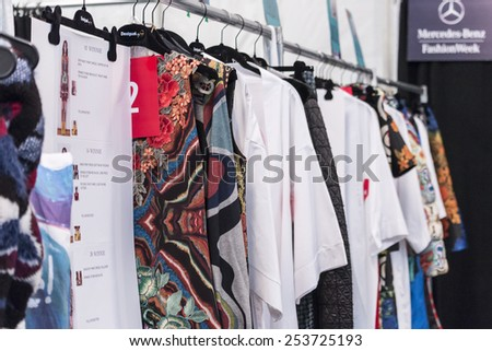 New York, NY, USA - February 12, 2015: A rack with clothes on the backstage for Desigual Fall 2015 Runway show during Mercedes-Benz Fashion Week New York at the Theatre at Lincoln Center, Manhattan - stock photo