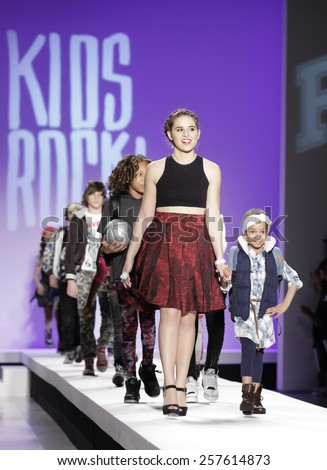 New York, NY, USA - February 12, 2015: Carly Rose Sonenclar walks runway with kids at the Nike Levi's Kids Rock runway show during Mercedes-Benz Fashion Week Fall 2015 at The Salon at Lincoln Center - stock photo