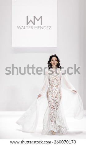 New York, NY, USA - February 19, 2015: Model walks runway for Walter Mendez Fall 2015 collection at the Art Hearts Fashion Presented By AIDS HF during MBFW at The Theatre at Lincoln Center - stock photo