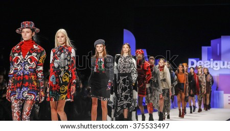 New York, NY, USA - February 11, 2016: Models walk the runway at the Desigual runway show during of Fall 2016 New York Fashion Week at The Arc, Skylight at Moynihan Station, Manhattan. - stock photo