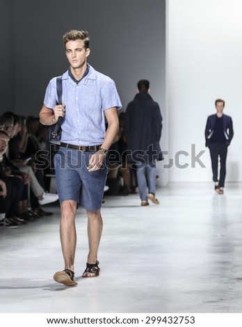 New York, NY, USA - July 14, 2015: A model walks runway at the Todd Snyder Runway show during New York Fashion Week: Men's S/S 2016 at Skylight Clarkson Sq, Manhattan - stock photo