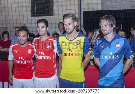 New York, NY, USA - July 25, 2014: (L-R) Footballers Santi Cazorla, Mikel Arteta, and Tomas Rosicky greet fans at PUMA partners w/ Arsenal Football Club to Debut Monumental Cannon event in GCS in NYC - stock photo