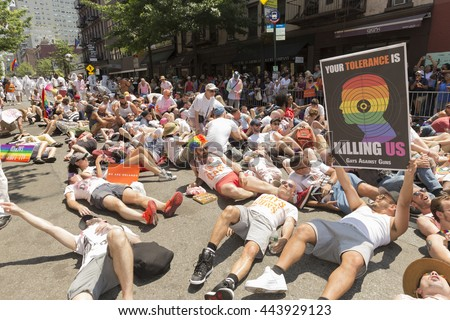 New York, NY USA - June 26, 2016: Atmosphere at 46th annual Pride parade to celebrate gay, lesbian and transgender community in New York city. Sit in against gun violence - stock photo