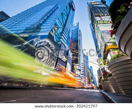 NEW YORK, NY, USA - June 12, 2015: Colorful intersection of 42nd Street and Times Square in New York City at night just after sunset - stock photo