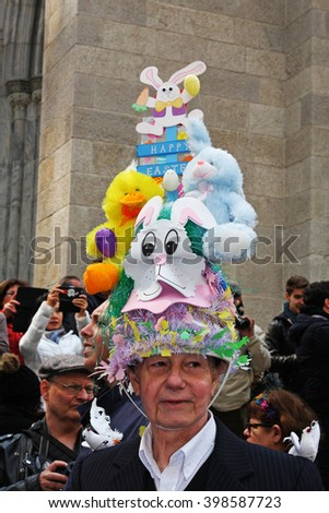 New York, NY USA- March 27, 2016: Man wears his highly decorated hat during the Easter Bonnet Parade along Fifth Avenue in New York City, - stock photo