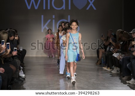 New York, NY USA - March 12, 2016: Young models walk runway for Wildfox Kids during petiteParade fashion show at Spring studios - stock photo