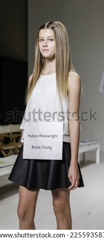 New York, NY, USA - October 19, 2014: A model walks the runway rehearsal during the Bonnie Young collection preview at petitePARADE/Kids Fashion Week at Bathhouse Studios, Manhattan - stock photo