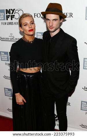 "NEW YORK-OCT 10: Actress Sienna Miller (L) and Tom Sturridge attend the ""Foxcatcher"" premiere at the 52nd New York Film Festival at Alice Tully Hall on October 10, 2014 in New York City. - stock photo"
