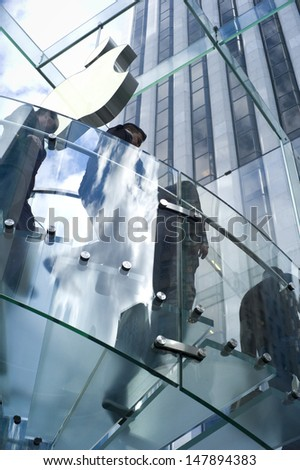 NEW YORK - OCT 21: Apple store on Fifth Avenue on October 21 2012 in New York City, USA. The store in it self is all underground except for the 32-foot glass cube right in front of the GM building - stock photo