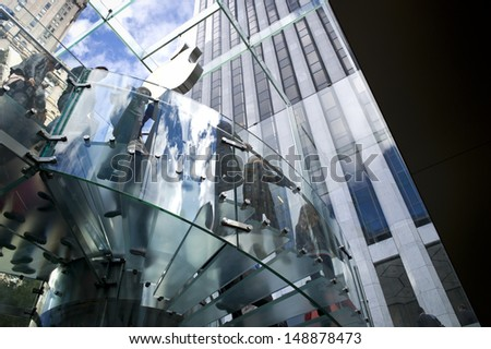 NEW YORK - OCT 21: Apple store on Fifth Avenue on October 21 2012 in New York City, USA. The store in it self is all underground except for the 32-foot glass cube right in front of f the GM building - stock photo